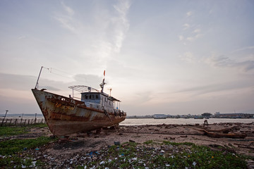Abandoned boat on the shore of Vietnam