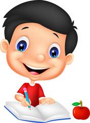 happy boy writing on a book