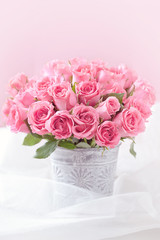 many beautiful fresh pink roses on a table.