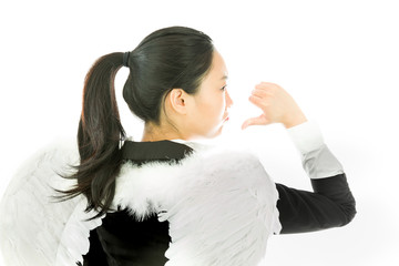 Rear view of angel side of a young Asian businesswoman showing