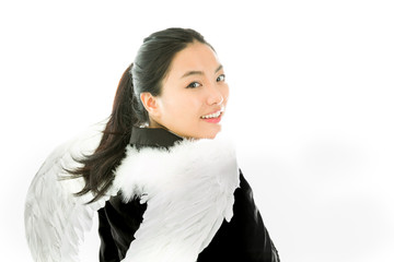 Rear view of angel side of a young Asian businesswoman smiling