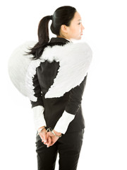 Angel side of a young Asian businesswoman with handcuffs and