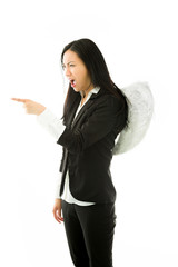 Angry Asian young businesswoman dressed up as an angel scolding