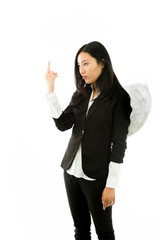 Asian young businesswoman dressed up as an angel pointing up