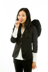 Asian young businesswoman dressed up as black angel thumbs in