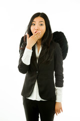 Surprised attractive Asian young businesswoman dressed up as