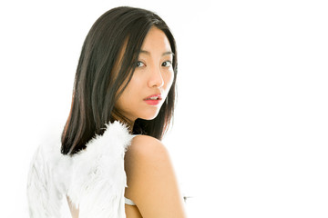 Angel side of a young Asian woman turning back and looking sad