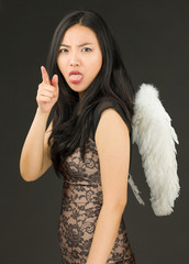 Asian young woman dressed up as an angel with sticking out her