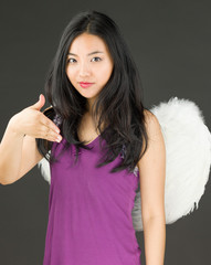 Angel side of a young Asian woman offering hand for handshake