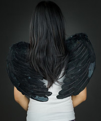 Rear view of a Asian young woman dressed up as an angel