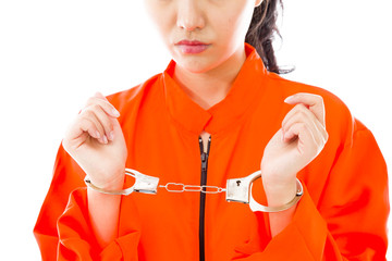 Handcuffed Asian young woman in prisoners uniform