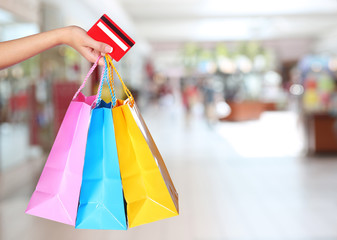 Wall Murals Indians Shopping! Female Hand Holding Colorful Shopping Bags and Credit