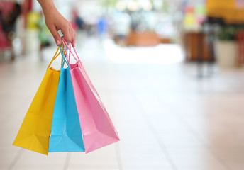 Wall Murals Indians Shopping! Female Hand Holding Colorful Shopping Bags in Shopping