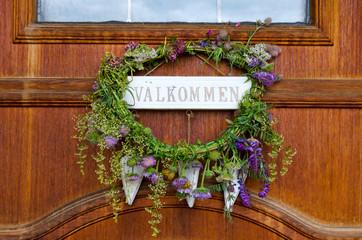 Swedish midsummer flower wreath on the house door