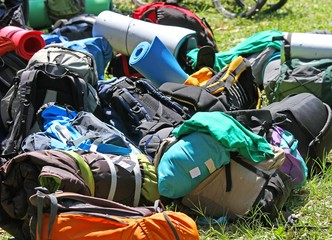 pile of knapsacks of Scouts during an excursion in the nature pa