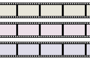 Ribbons of movie film isolated on white