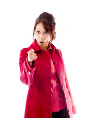 Shocked Indian young woman pointing towards camera