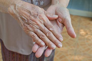 Old senior woman hands wrinkled skin