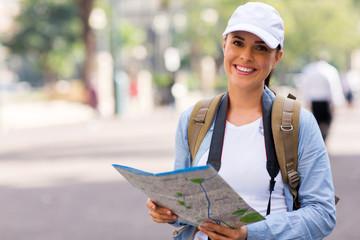 Obraz young tourist holding a map - fototapety do salonu