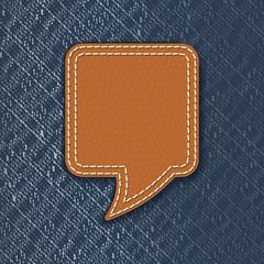 Leather speech bubble on jeans texture