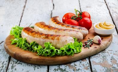 Fototapete - Grilled chicken sausages