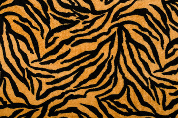 Brown and black tiger pattern.Fur animal print as background.