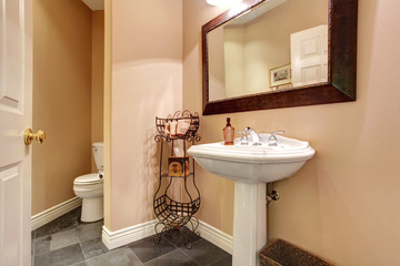 Bathroom interior with white washbasin stand