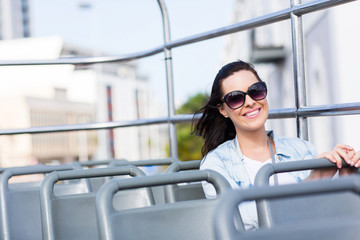 attractive young woman on an open top bus
