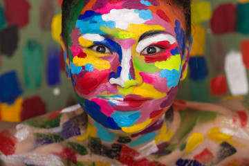 Smiling asian woman with face art