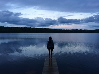 Girl standing on a pier