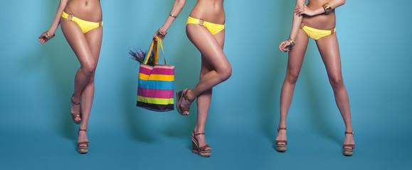 Legs of summer girl in bikini