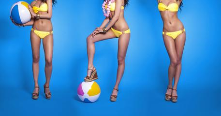 Part of sexy woman in yellow bikini
