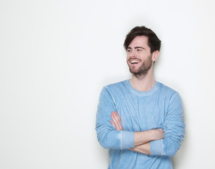 Attractive man smiling with arms crossed