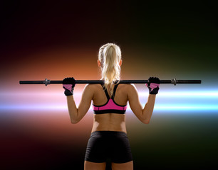 sporty woman exercising with barbell