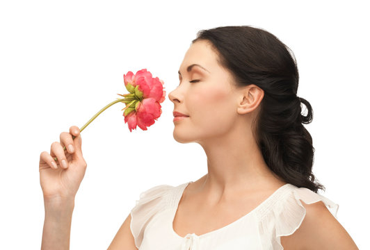 young and beautiful woman smelling flower