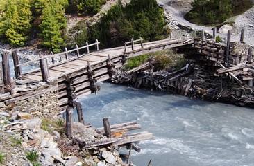 Wooden foot bridge over a glacial river, Himalayas, Nepal