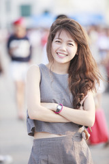 beautiful asian teen age standing with relaxing and smiling to c