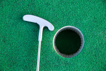 Golf stick near the hole
