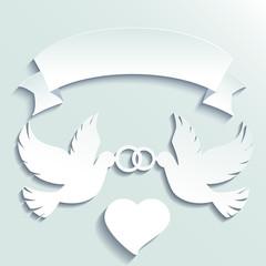 Doves holding wedding rings