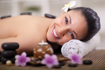 beautiful smiling woman relaxing in spa center