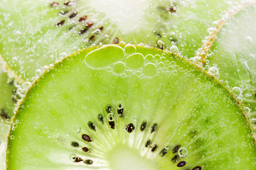 Background fruit kiwi texture with bubbles
