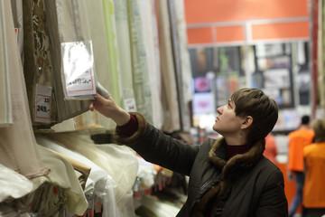 Person choosing fabrics