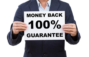 Business man hand holding paper Money back 100% guarantee  isola