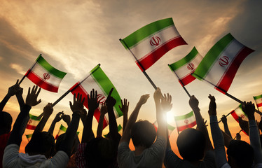Silhouettes of People Holding the Flag of Iran