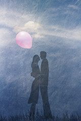 couple in love with a balloon on the sky background with cloud