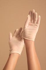 woman adjusting vintage white gloves