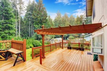 Walkout deck with attached pergola