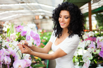 Woman looking at flowers in a greenhouse