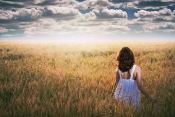 Woman staring at a dramatic sky
