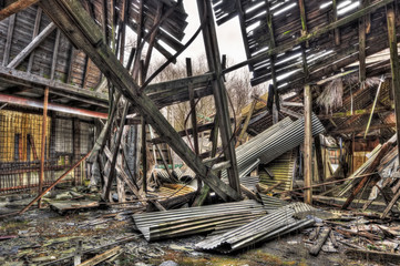 Collapsed roof of tumbledown warehouse